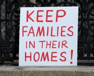 """Sign reading """"Keep families in their homes!"""""""